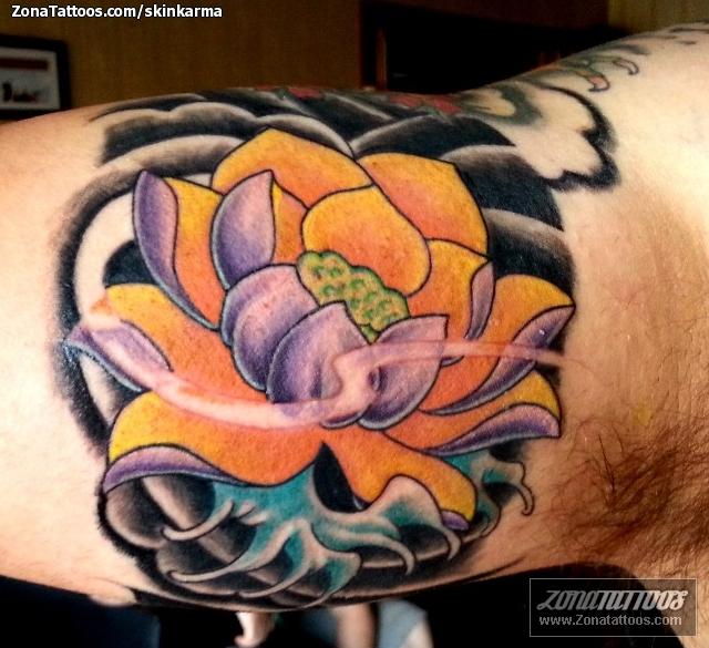Tattoo Of Lotus Biceps Flowers